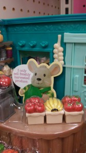 This mouse was found in the toy aisles of Target, trying to pass off his bananas as freshly harvested. I don't buy it, food elitist! Unless you're speaking English with a Latin-American accent, you're a food elitist! BUSTED!!!